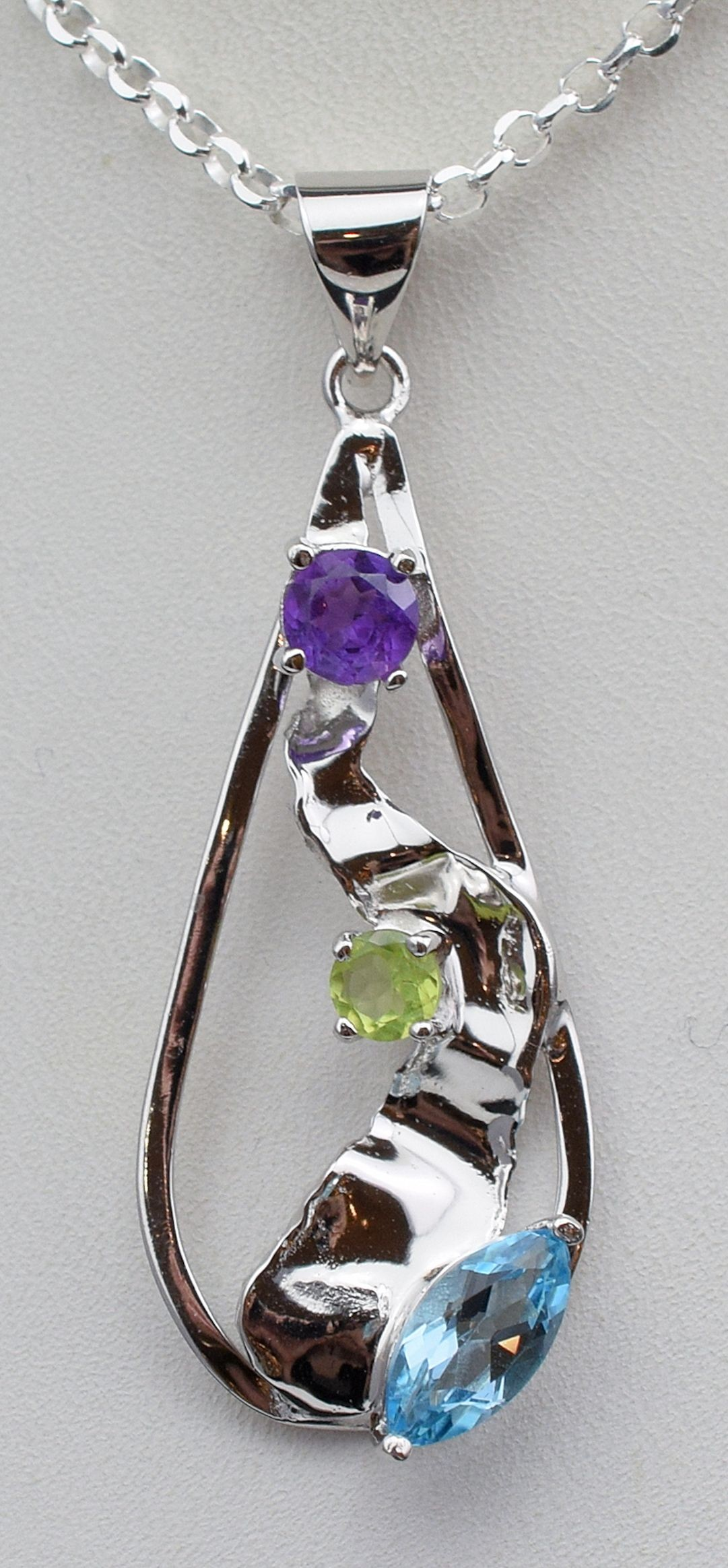 Pds 0597 Amethyst, Peridot and Blue Topaz Pendant in Sterling Silver.